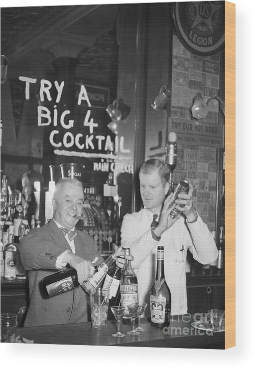 Mixing Wood Print featuring the photograph Bartenders Mixing Drinks by Bettmann