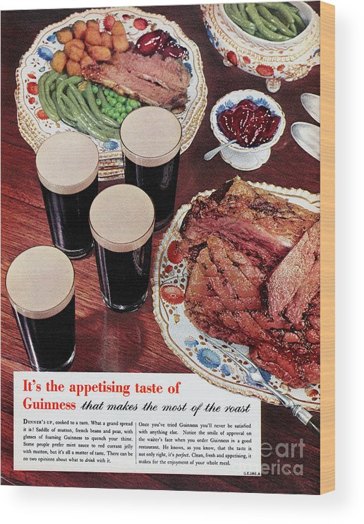 Stout Ale Wood Print featuring the photograph Guinness by Picture Post