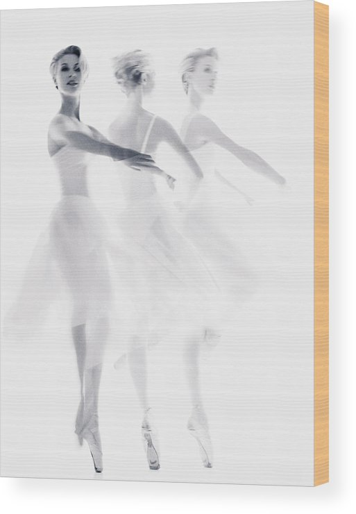 Ballet Dancer Wood Print featuring the photograph Ballet Dancer Pirouetting Multiple by Getty Images