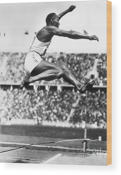 The Olympic Games Wood Print featuring the photograph Jesse Owens In Midair by Bettmann