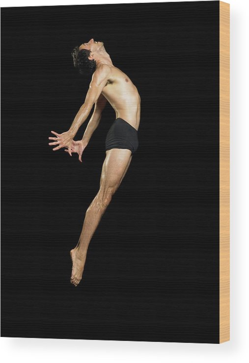 Human Arm Wood Print featuring the photograph Male Dancer Jumping by Image Source