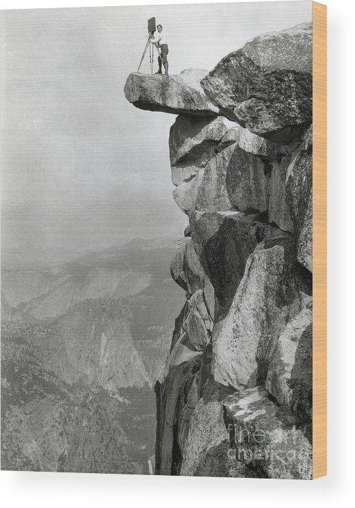 People Wood Print featuring the photograph Photographer Standing On Mountain Ledge by Bettmann