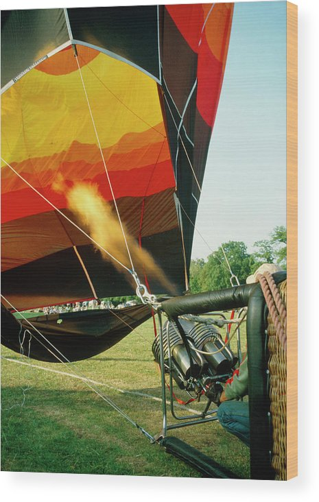 Flame Wood Print featuring the photograph Inflation Of A Hot Air Balloon by David Taylor/science Photo Library