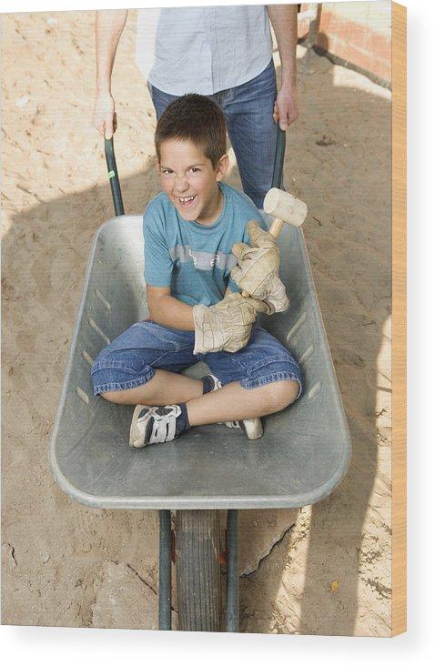 Father Pushing Son 6 8 In Wheelbarrow Portrait Of Boy Smiling Wood Print