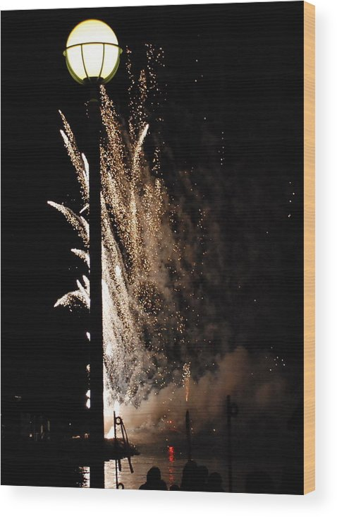 Fireworks Wood Print featuring the photograph Fireworks Behind The Street Light by Gene Sizemore