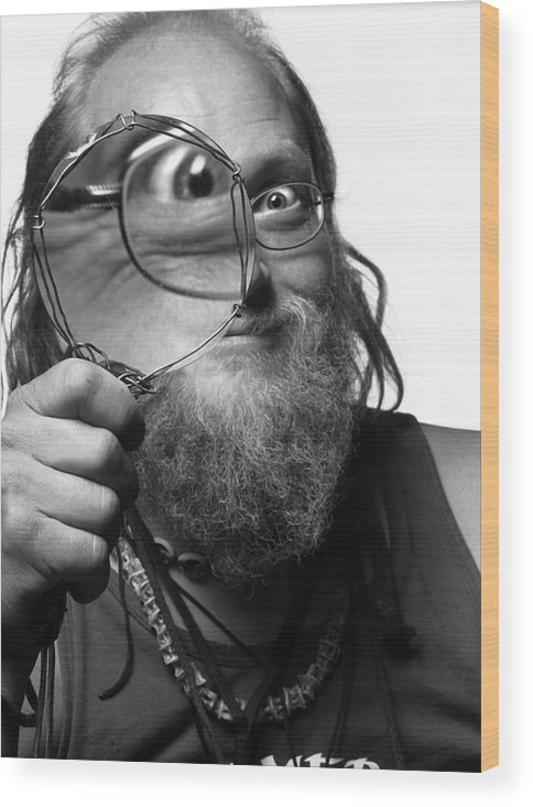 Man Black And White Eye Glasses Hand Beads Hair Portrait Wood Print featuring the photograph The Token Hippie by Alex Lemus