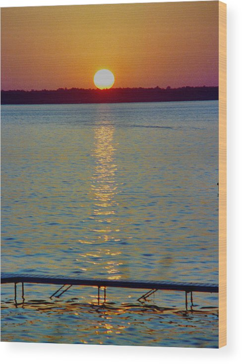 Sunset Wood Print featuring the photograph Quite Pier Sunset by Randy Oberg