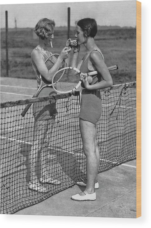 Shadow Wood Print featuring the photograph Lighting Up After A Tennis Match by Fpg