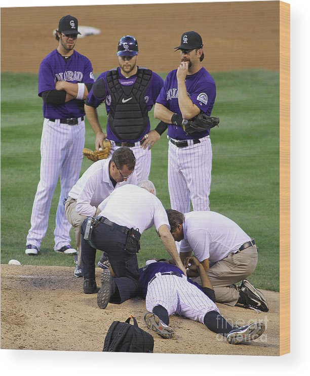 Sports Ball Wood Print featuring the photograph Washington Nationals V Colorado Rockies by Marc Piscotty