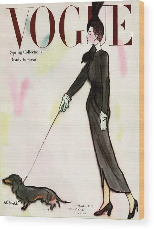 Fashion Wood Print featuring the photograph Vogue Cover Featuring A Woman Walking A Dog by Rene R. Bouche