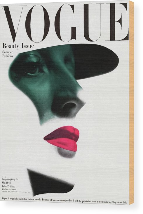 Fashion Wood Print featuring the photograph Vogue Cover Featuring A Woman's Face by Erwin Blumenfeld