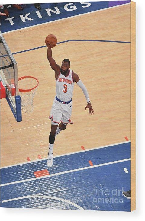 Tim Hardaway Jr. Wood Print featuring the photograph New York Knicks V Cleveland Cavaliers by Jesse D. Garrabrant