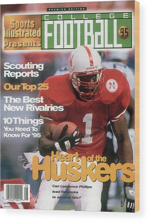 Motion Wood Print featuring the photograph 1995 College Football Preview Issue Sports Illustrated Cover by Sports Illustrated
