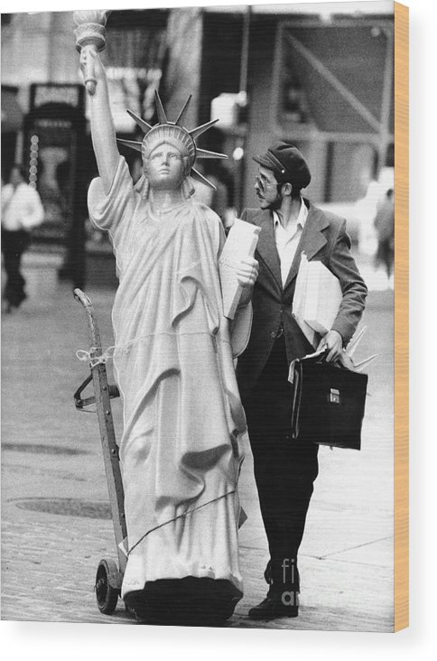 1980-1989 Wood Print featuring the photograph A Model Of Lady Liberty Was Being Sold by New York Daily News Archive