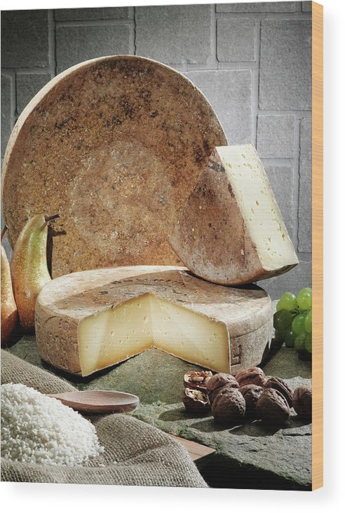 Fontina Wood Print featuring the photograph Cheese, Fruit And Grains On Table by Walter Zerla