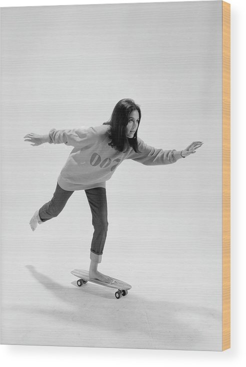 Timeincown Wood Print featuring the photograph Gloria Steinem On A Skateboard by Yale Joel