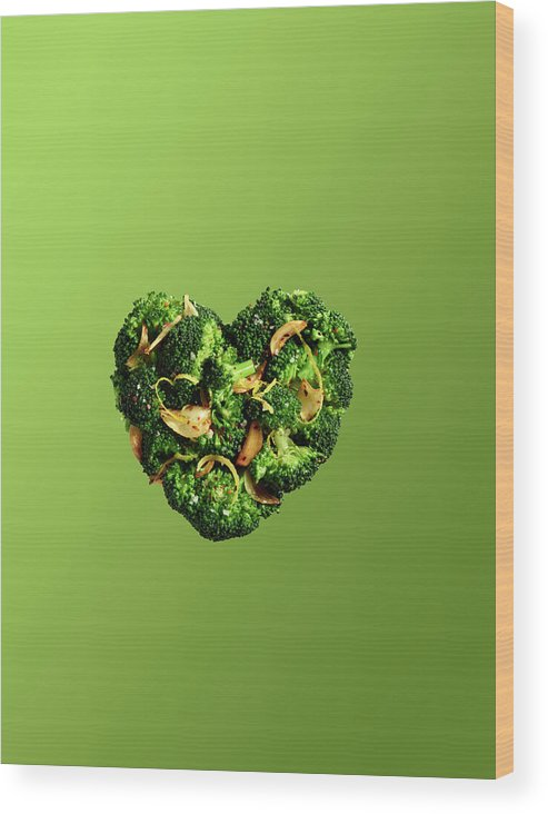 Broccoli Wood Print featuring the photograph Heart Shaped Broccoli On Green by Maren Caruso