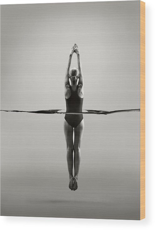 Diving Into Water Wood Print featuring the photograph Rear View Of Female Swimmer by Jonathan Knowles
