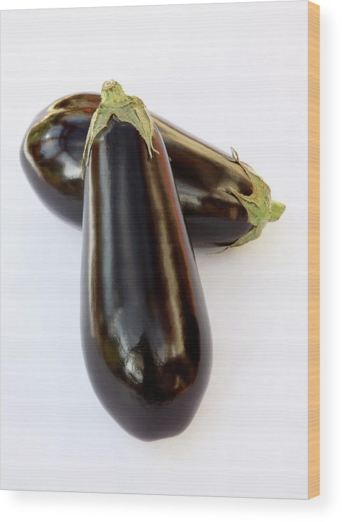 White Background Wood Print featuring the photograph Ripe, Organic Aubergines On White by Rosemary Calvert