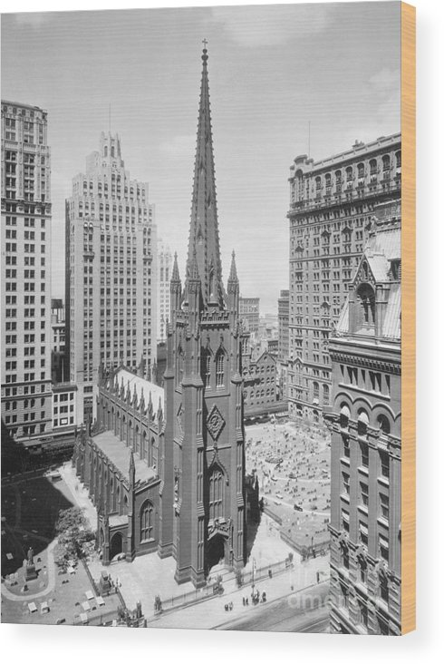1930-1939 Wood Print featuring the photograph Trinity Church On Wall Street by Bettmann