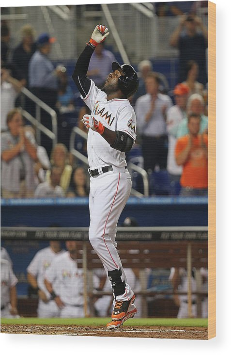 American League Baseball Wood Print featuring the photograph Marcell Ozuna by Mike Ehrmann
