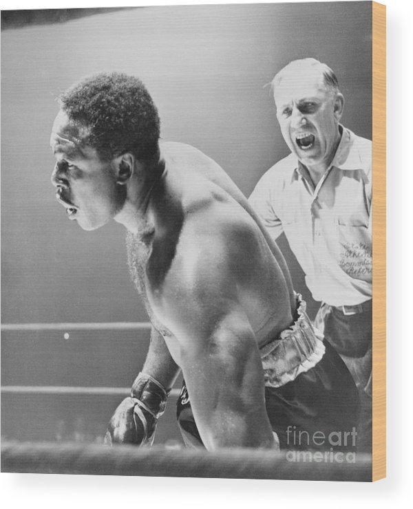 Mature Adult Wood Print featuring the photograph Referee Counting As Boxer Archie Moore by Bettmann