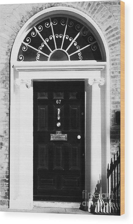 Dublin Wood Print featuring the photograph Black Georgian Door With Brass Letterbox Door Knob And Knocker And Fanlight In Dublin by Joe Fox