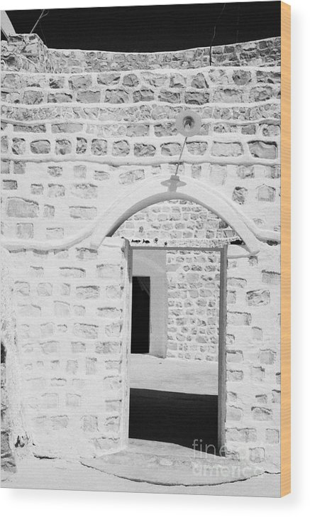 Tunisia Wood Print featuring the photograph close up of front doorway entrance to family home berber troglodyte underground dwelling at Matmata Tunisia by Joe Fox