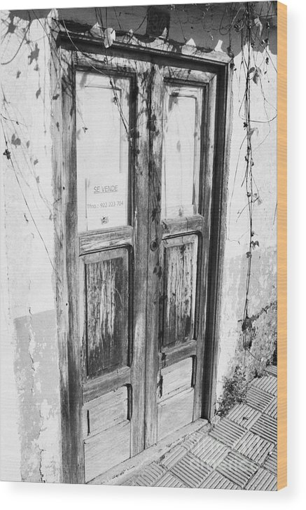 Europe Wood Print featuring the photograph old weathered brown wooden door entrance to abandoned house with cracked stucco walls and for sale sign in spanish in Tacoronte Tenerife Canary Islands Spain by Joe Fox