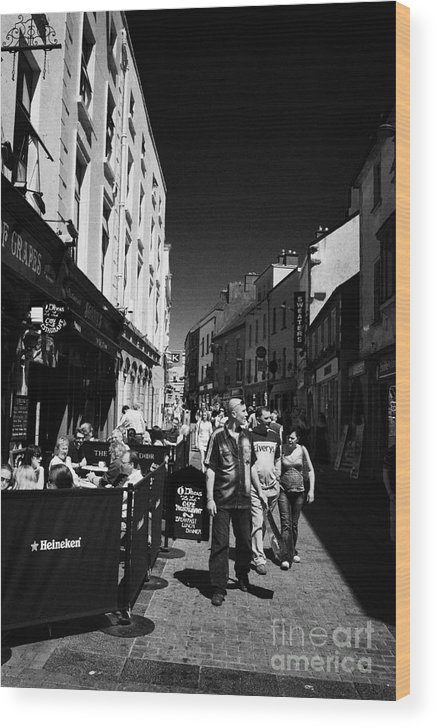 Galway Wood Print featuring the photograph Pedestrians And Drinkers Enjoying A Sunday Afternoon Drink In The Bunch Of Grapes Pub Galway by Joe Fox