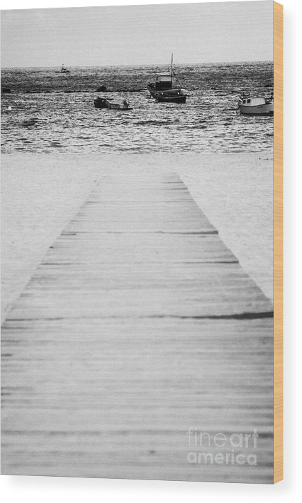 Europe Wood Print featuring the photograph wooden walkway across beach leading down to boats in the sea Playa De Las Teresitas North Tenerife Canary Islands Spain by Joe Fox