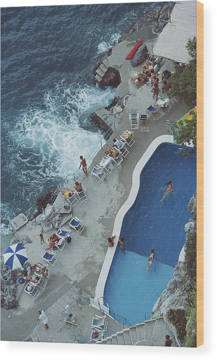 1980-1989 Wood Print featuring the photograph Pool On Amalfi Coast by Slim Aarons