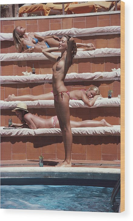 1980-1989 Wood Print featuring the photograph Sunbathing On Capri by Slim Aarons