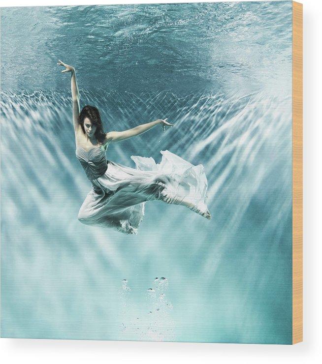 Underwater Wood Print featuring the photograph Female Dancer Under Water by Henrik Sorensen