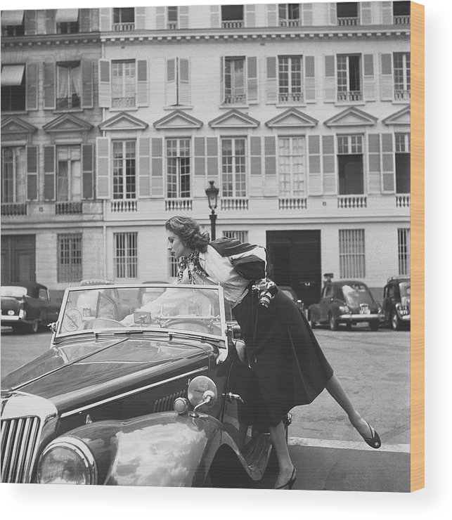 Personality Wood Print featuring the photograph Suzy Parker Outside The French Vogue Office by Jacques Boucher