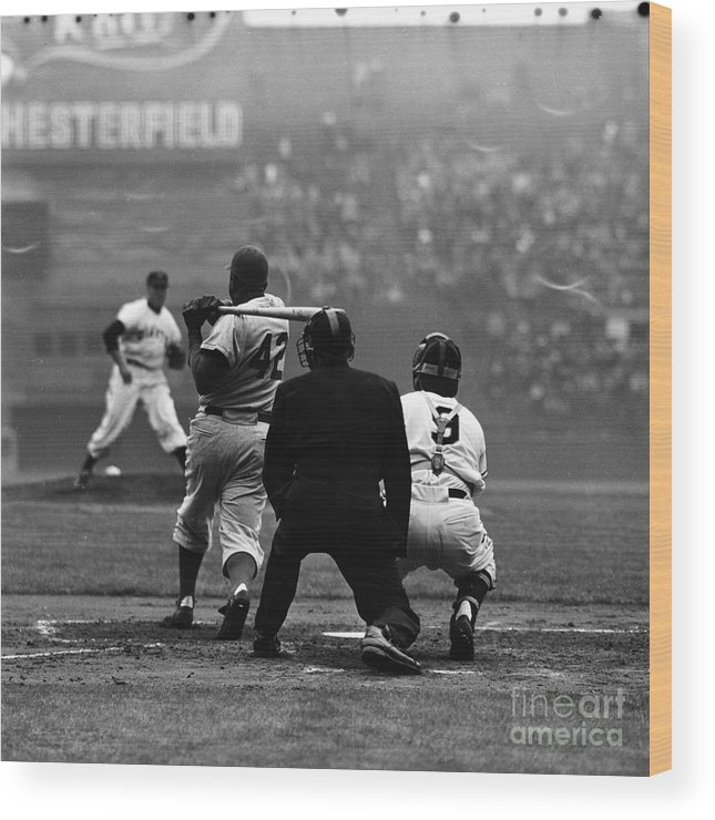 Sports Helmet Wood Print featuring the photograph Jackie Robinson At Bat Against Pitcher by Robert Riger