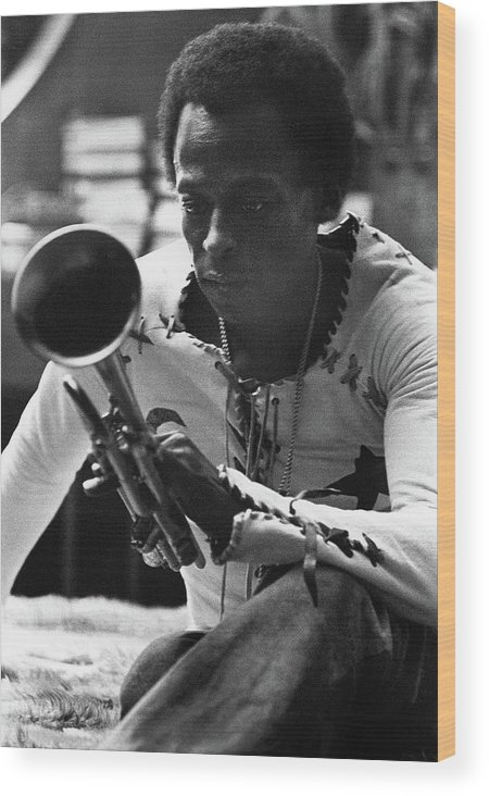 Artist Wood Print featuring the photograph Jazz Musician Miles Davis Looking At His Trumpet by Mark Patiky