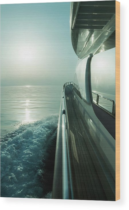 Desaturated Wood Print featuring the photograph Luxury Motor Yacht Sailing At Sunset by Petreplesea