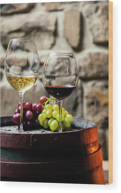 Alcohol Wood Print featuring the photograph Two Glasses Of Red And White Wine In by Piranka