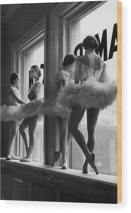 Ballet Dancer Wood Print featuring the photograph Ballerinas Standing On Window Sill In by Alfred Eisenstaedt