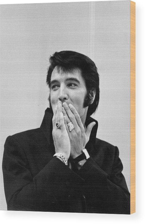 Elvis Presley Wood Print featuring the photograph Rock And Roll Musician Elvis Presley by Michael Ochs Archives