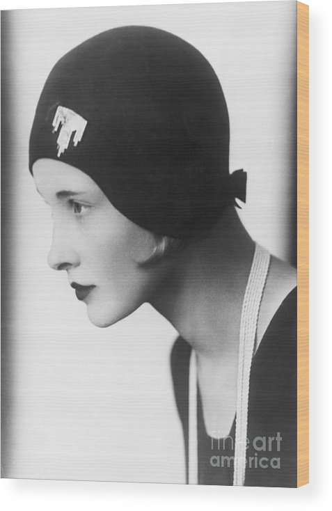 People Wood Print featuring the photograph A Woman Modeling A Cloche by Bettmann