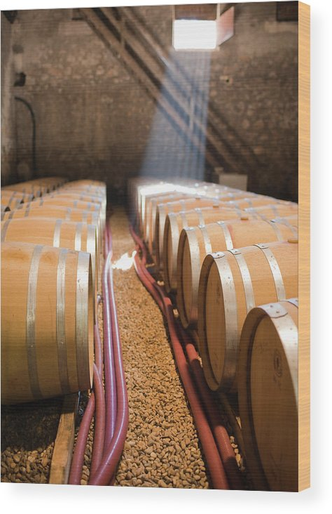 Alcohol Wood Print featuring the photograph Barrels In Wine Cellar by Johner Images