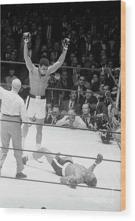 Human Arm Wood Print featuring the photograph Muhammad Ali Knocks Out Cleveland by Bettmann