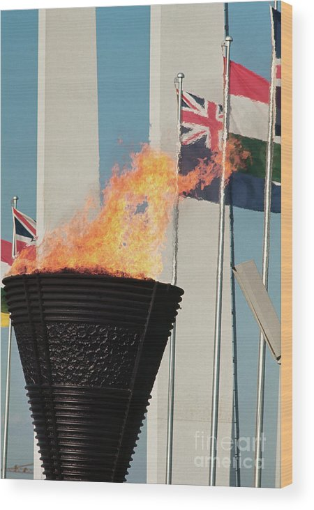 The Olympic Games Wood Print featuring the photograph Olympic Torch by Bettmann