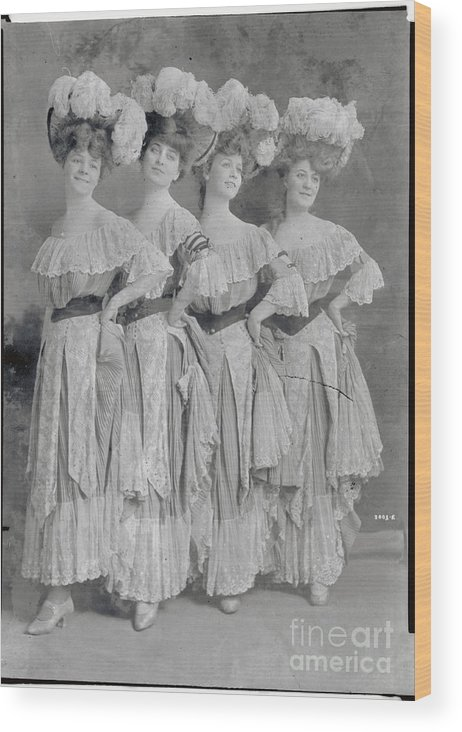 People Wood Print featuring the photograph Showgirls Wearing Typical Stage Attire by Bettmann
