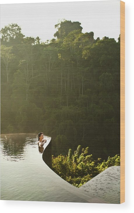 Tropical Rainforest Wood Print featuring the photograph Woman In Infinity Pool At Sunrise. Bali by Matthew Wakem