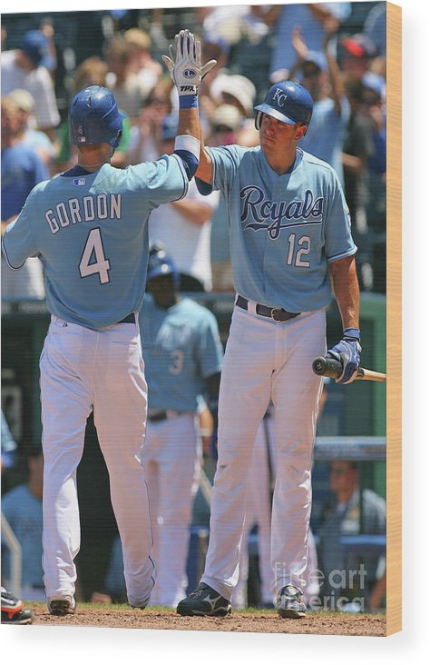 American League Baseball Wood Print featuring the photograph Alex Gordon and Mitch Maier by Tim Umphrey