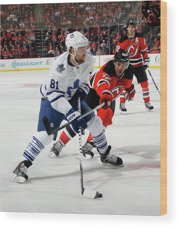 National Hockey League Wood Print featuring the photograph Toronto Maple Leafs V New Jersey Devils by Bruce Bennett