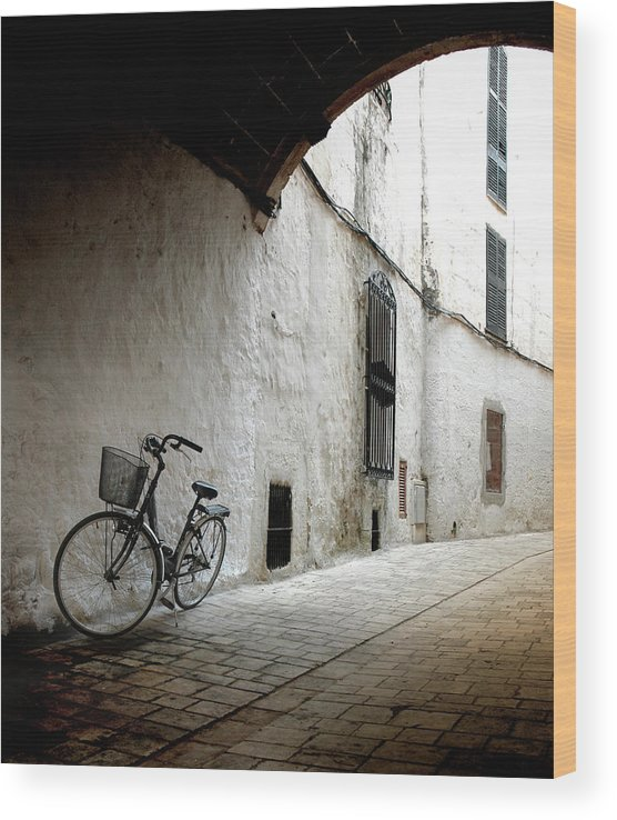 Tranquility Wood Print featuring the photograph Bicycle Leaning Wall by Antonio R. Ramos